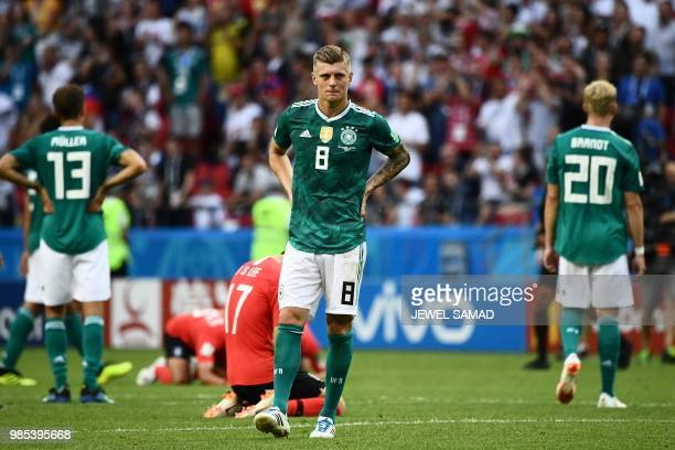 TOPSHOT Germany's forward Thomas Mueller Germany's midfielder Toni Kroos and Germany's forward Julian Brandt react after South Korea's forward Son...