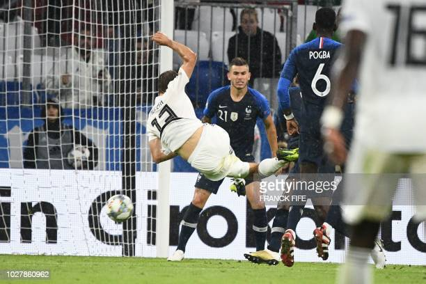 Germany's forward Thomas Mueller kicks the ball in front of France's defender Lucas Hernandez during the UEFA Nations League football match Germany...