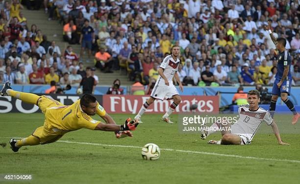 Germany's forward Thomas Mueller reacts after missing a shot on goal during the 2014 FIFA World Cup final football match between Germany and...