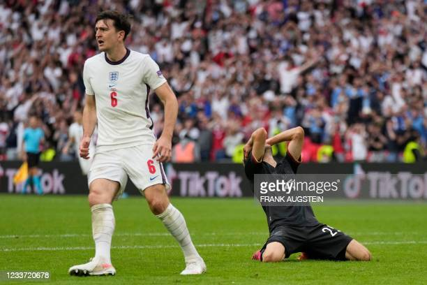 Germany's forward Thomas Mueller reacts to missing a goal opportunity during the UEFA EURO 2020 round of 16 football match between England and...
