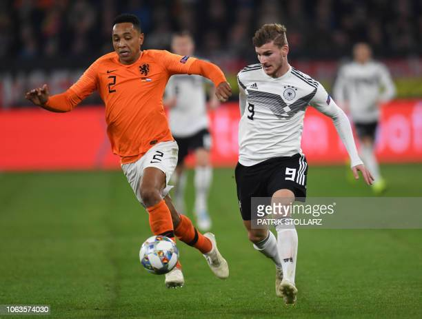 Germany's forward Timo Werner and Netherlands' defender Kenny Tete vie for the ball during the UEFA Nations League football match between Germany and...