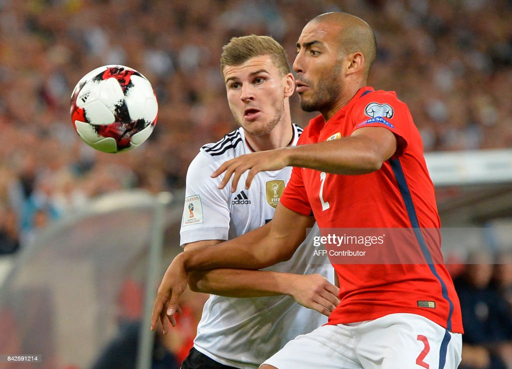 Germany's forward Timo Werner (L) and Norway's defender Haitam Aleesami vie for the ball during the FIFA World Cup 2018 qualification match between Germany and Norway in the south German city of Stuttgart on September 4, 2017. /