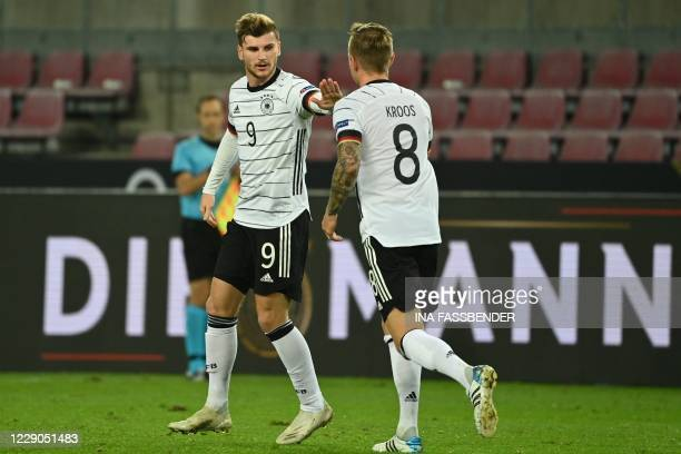 Germany's forward Timo Werner celebrates scoring with his team-mate Germany's midfielder Toni Kroos during the UEFA Nations League football match...