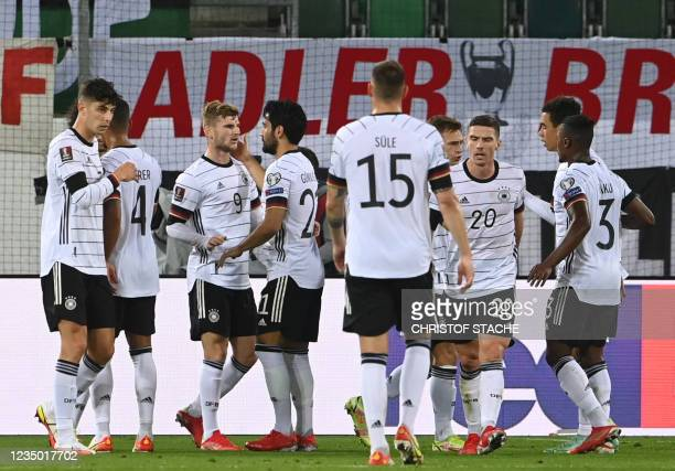 Germany's forward Timo Werner celebrates with teammates scoring during the FIFA World Cup Qatar 2022 qualification Group J football match between...