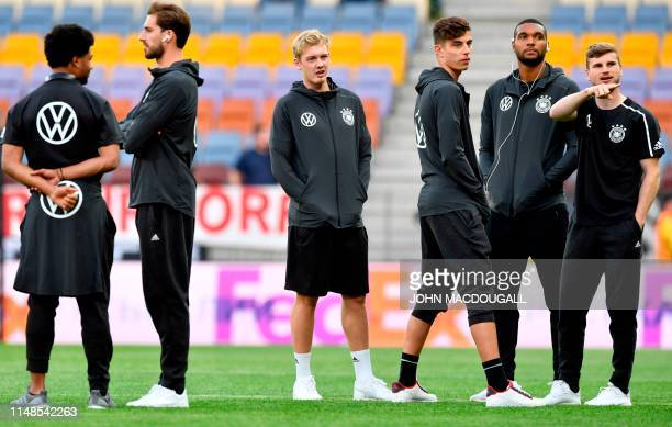 Germany's forward Timo Werner , Germany's defender Jonathan Tah , Germany's forward Julian Brandt and teammates inspect the pitch prior to the Euro...