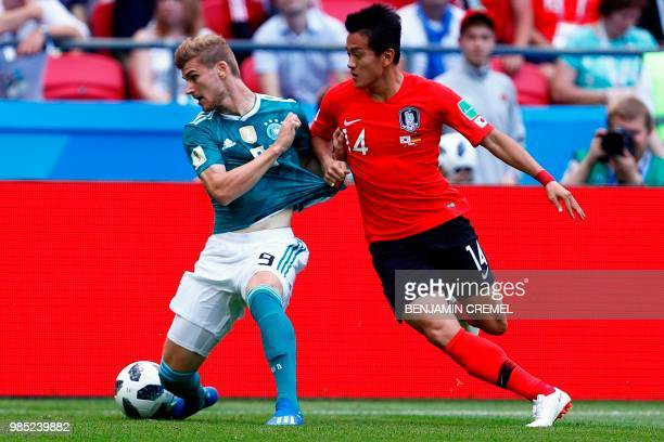 TOPSHOT Germany's forward Timo Werner is marked by South Korea's defender Hong Chul during the Russia 2018 World Cup Group F football match between...