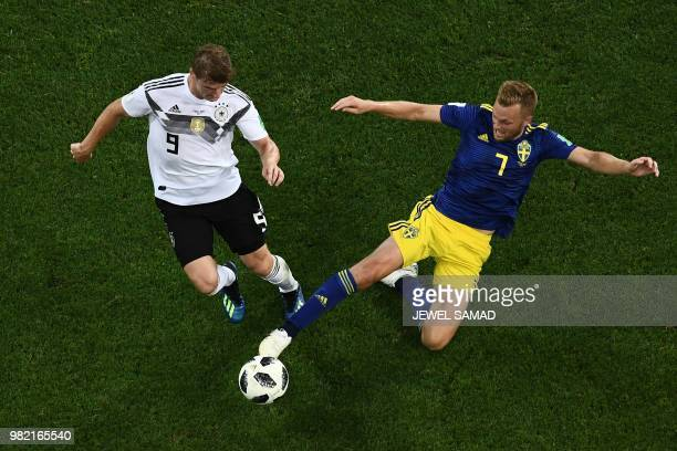 Germany's forward Timo Werner is tackled by Sweden's midfielder Sebastian Larsson during the Russia 2018 World Cup Group F football match between...