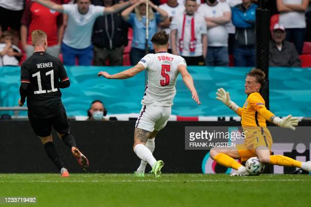 Germany's forward Timo Werner misses a goal opportunity as England's goalkeeper Jordan Pickford makes a save during the UEFA EURO 2020 round of 16...
