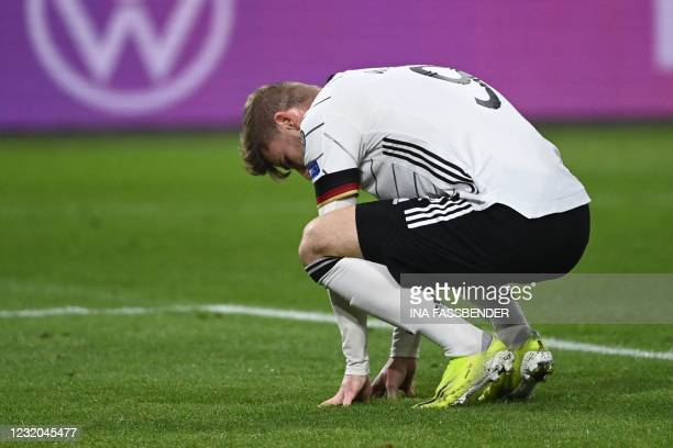 Germany's forward Timo Werner reacts after missing during the FIFA World Cup Qatar 2022 qualification football match Germany v North Macedonia in...