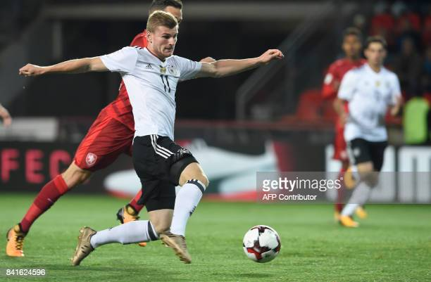 Germany's forward Timo Werner scores the opening goal during the FIFA World Cup 2018 qualification football match between Czech Republic and Germany...