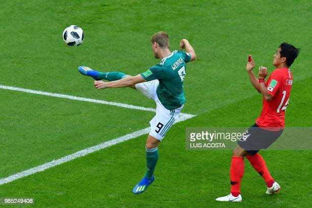 TOPSHOT Germany's forward Timo Werner takes a shot ahead of South Korea's defender Hong Chul during the Russia 2018 World Cup Group F football match...