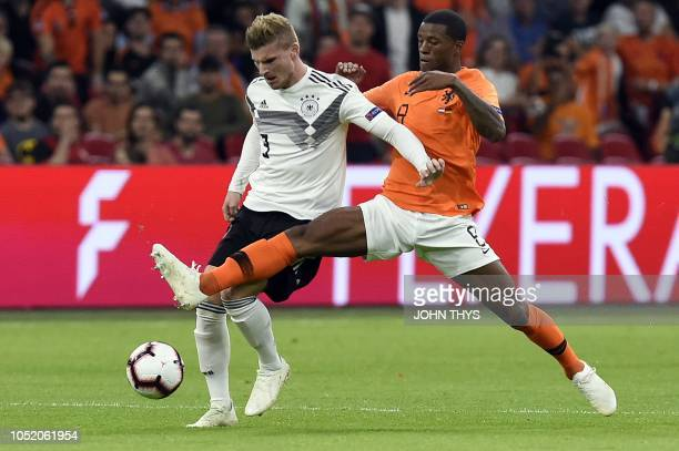 Germany's forward Timo Werner vies with Netherlands' midfielder Georginio Wijnaldum during the UEFA Nations League football match between Netherlands...