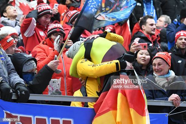 TOPSHOT Germany's Francesco Friedrich celebrates during the victory ceremony after his team won the gold medal at the end of in the 2man bobsleigh...