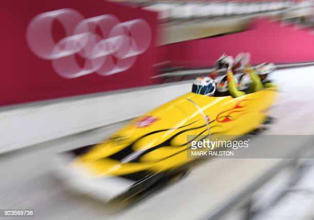 TOPSHOT Germany's Francesco Friedrich leads his team in the 4man bobsleigh heat 2 run during the Pyeongchang 2018 Winter Olympic Games at the Olympic...