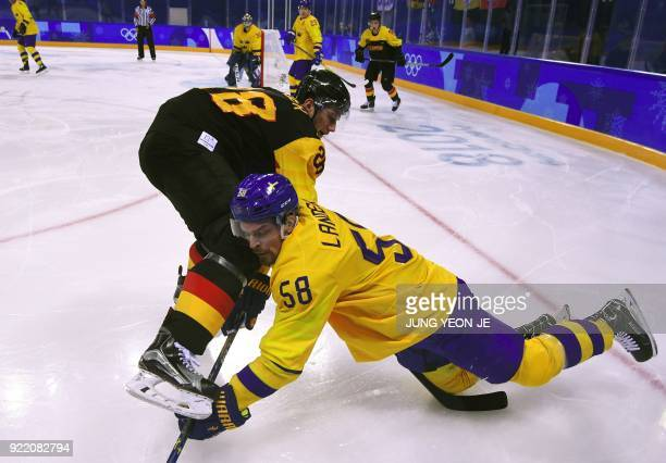TOPSHOT Germany's Frank Mauer and Sweden's Anton Lander fight for the puck in the men's quarterfinal ice hockey match between Sweden and Germany...