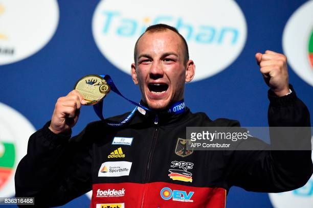 Germany's Frank Staebler celebrates after winning the men's GrecoRoman Seniors 71kg category event of the FILA World Wrestling Championships on...