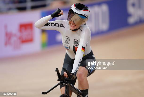Germany's Franziska Brausse celebrates after the women's individual pursuit final at the UCI track cycling World Championship at the velodrome in...