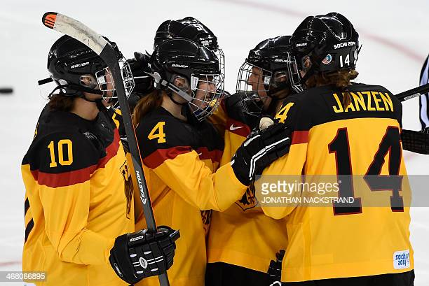 Germany's Franziska Busch celebrates with her teammates after scoring a goal during the Women's Ice Hockey Group B match between Russia and Germany...