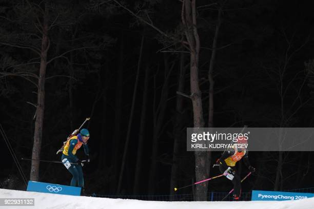 Germany's Franziska Hildebrand and Ukraine's Yuliia Dzhima compete in the women's 4x6km biathlon event during the Pyeongchang 2018 Winter Olympic...