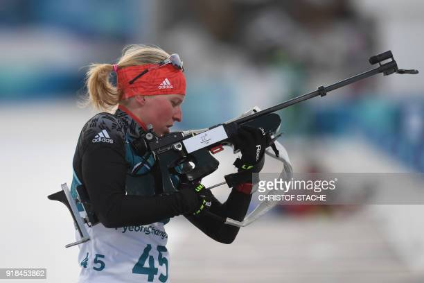 Germany's Franziska Hildebrand competes at the range in the women's 15km individual biathlon event at the Alpensia biathlon center during the...
