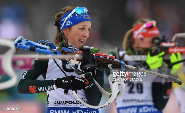 Germany's Franziska Preuss reacts after the last shooting as she competes to win the women's 12,5 km mass start competion of the IBU Biathlon World...