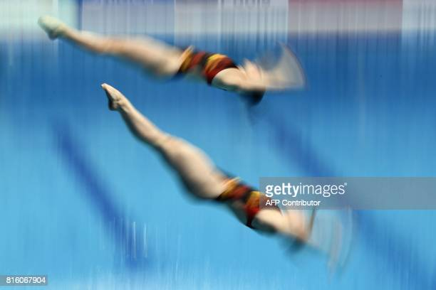 Germany's Friederike Feyer and Germany's Tina Punzel compete in the women's 3m springboard synchro final during the diving competition at the 2017...