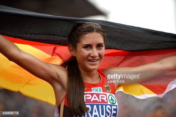 Germany's GesaFelicitas Krause celebrates as she wins the 3000 Steeplechase women final during the European Athletics Championships in Amsterdam at...