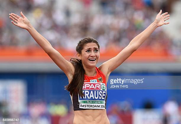Germany's GesaFelicitas Krause reacts as she crosses the finish line to win the women's 3000 Steeplechase final during the European Athletics...