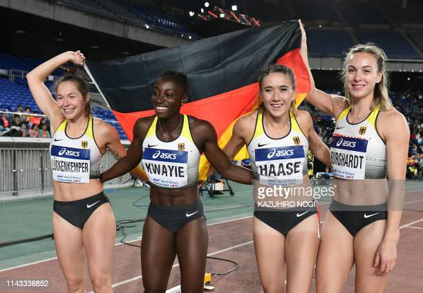 Germany's Gina Luckenkemper Lisa Marie Kwayie Rebekka Haase and Alexandra Burghardt celebrate their third place after the women's 4x100 metres relay...