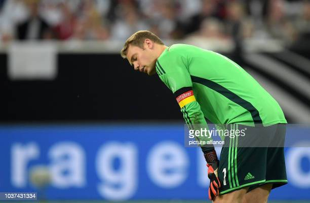 Germany's goal keeper ManuelNeuer reacts after the second goal against during the international soccer match between Germany and Argentina at Esprit...
