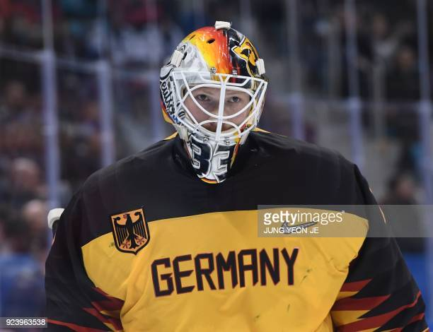 Germany's goalie Danny aus den Birken looks on in the men's gold medal ice hockey match between the Olympic Athletes from Russia and Germany during...