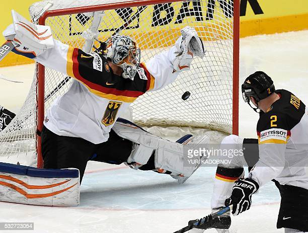 Germany's goalie Thomas Greiss lets the puck into his net during the quarterfinal game Russia vs Germany at the 2016 IIHF Ice Hockey World...
