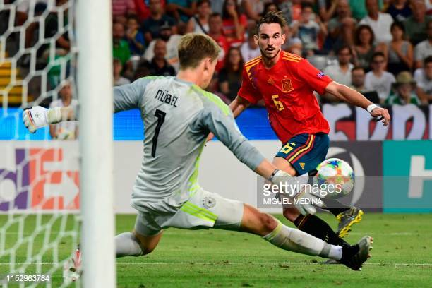 Germany's goalkeeper Alexander Nuebel defelects a shot from Spain's midfielder Fabian Ruiz during the final match of the UEFA U21 European Football...