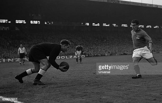Germany's goalkeeper Anton Turek and France's Andre Strappe during a friendly match between France and Germany