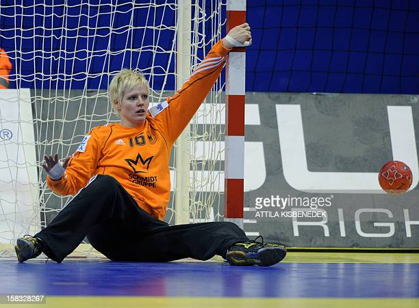 Germany's goalkeeper Clara Woltering makes a save against Romania during the 2012 EHF European Women's Handball Championship Group II match of main...