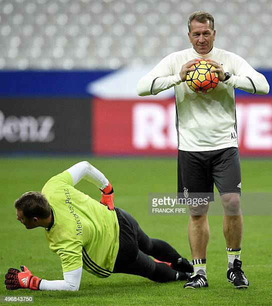 Germany's goalkeeper coach Andreas Kopke and Germany's goalkeeper Manuel Neuer take part in a training session at the Stade de France stadium in...
