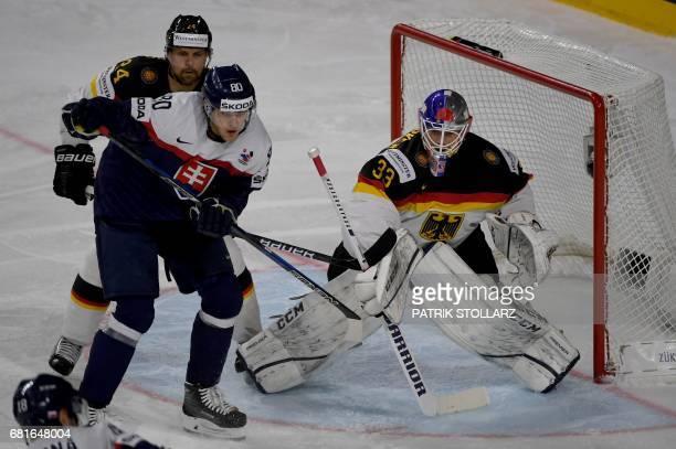 Germany´s goalkeeper Danny Aus den Birken Dennis Seidenberg and Slovakia´s Tomas Hrnka vie during the IIHF Ice Hockey World Championships first round...