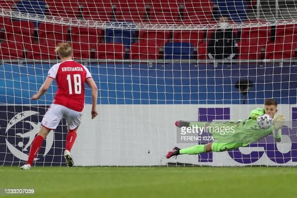 Germany's goalkeeper Finn Dahmen saves Denmark's midfielder Victor Bernth Kristansen's shot during the penalty shoot-out of the UEFA Under21...