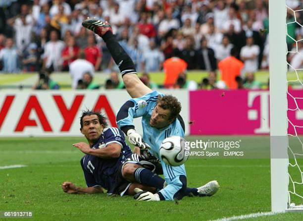 Germany's goalkeeper Jens Lehmann saves from Argentina's Carlos Tevez