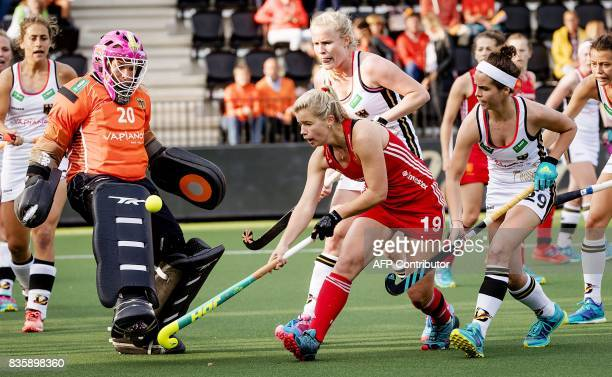 Germany's goalkeeper Julia Ciupka fights for the ball with Sophie Bray of England during the Women's Rabo EuroHockey Championships match between...