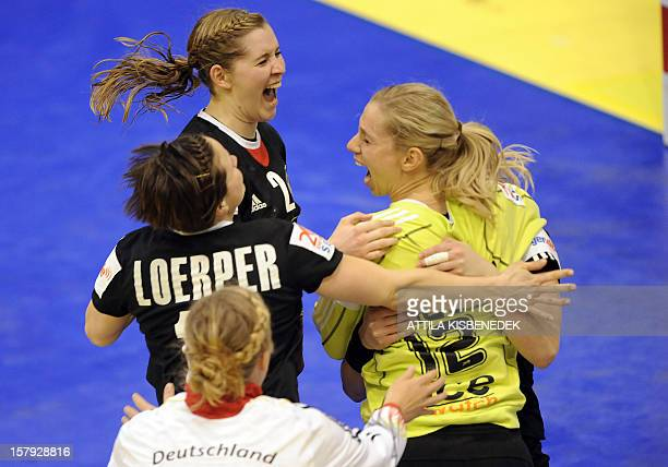Germany's goalkeeper Katja Schulke celebrates her last seconds save in the second half with teammates Natalie Augsburg Marlene Zapf and Anna Loerper...