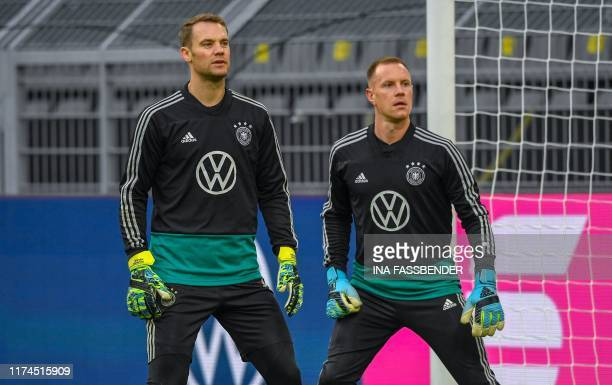 Germany's goalkeeper Manuel Neuer and Germany's goalkeeper Marc-Andre Ter Stegen attend a training session of the German national football in...