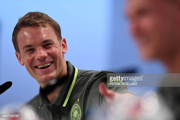 Germany's goalkeeper Manuel Neuer attends a press conference at Germany's training grounds in Evian eastern France on June 24 during the Euro 2016...