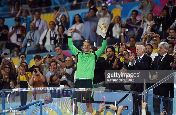 ad90c79c666 Germany s goalkeeper Manuel Neuer celebrates after receiving the Golden  Glove award for best goalkeeper after Germany