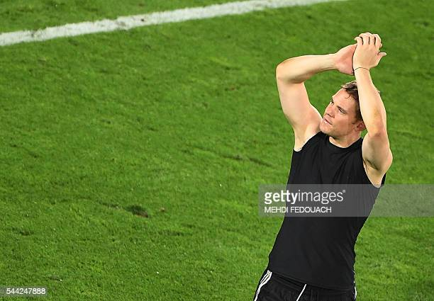 Germany's goalkeeper Manuel Neuer celebrates after winning the Euro 2016 quarter-final football match between Germany and Italy at the Matmut...
