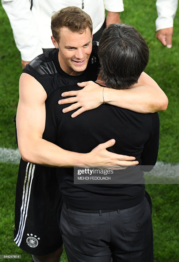 Germany's goalkeeper Manuel Neuer (L) celebrates with Germany's coach Joachim Loew after winning the Euro 2016 quarter-final football match between Germany and Italy at the Matmut Atlantique stadium in Bordeaux on July 2, 2016. / AFP / Mehdi FEDOUACH