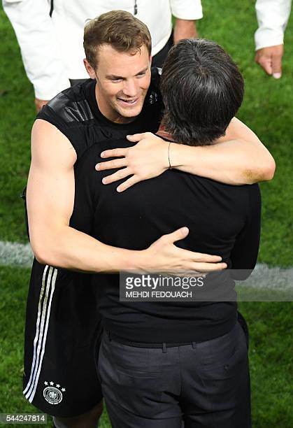 Germany's goalkeeper Manuel Neuer celebrates with Germany's coach Joachim Loew after winning the Euro 2016 quarter-final football match between...