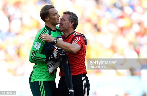 Germany's goalkeeper Manuel Neuer celebrates with the German team's goalkeeper's coach Andreas Kopke after winning the quarterfinal football match...