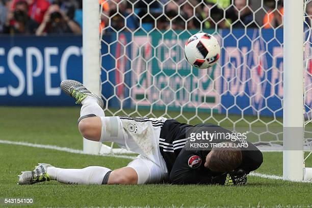Germany's goalkeeper Manuel Neuer ducks as he saves a shot on goal during the Euro 2016 round of 16 football match between Germany and Slovakia at...