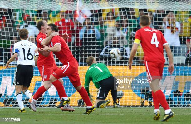 Germany's goalkeeper Manuel Neuer eyes the ball after conceding a denied goal by England's midfielder Frank Lampard during the 2010 World Cup round...